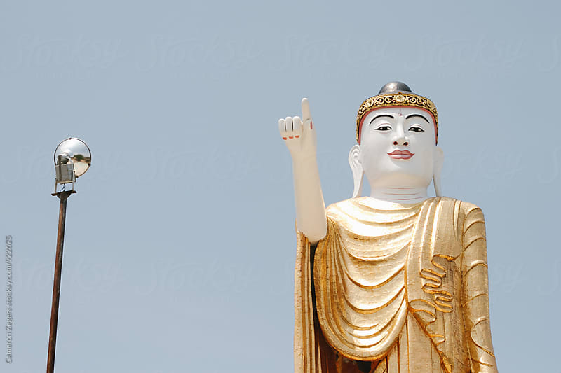 Buddha statue at temple in Burma by Cameron Zegers for Stocksy United