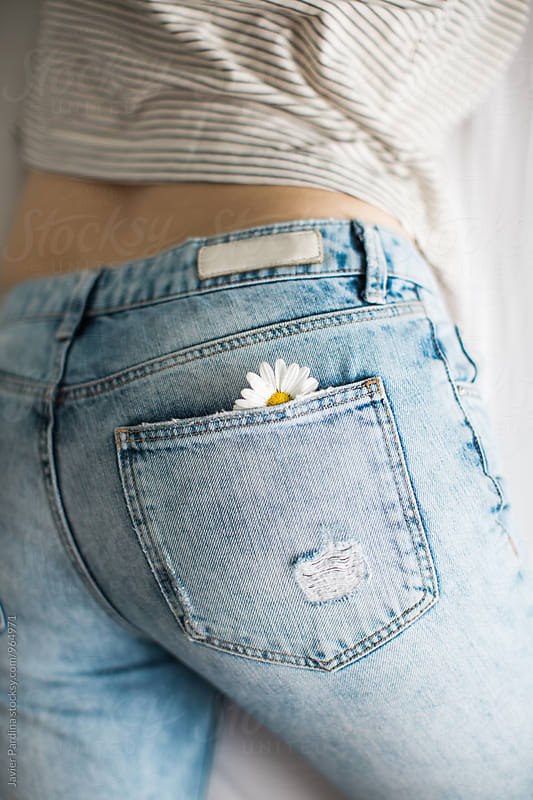 Woman with flowers in the pocket by Javier Pardina for Stocksy United