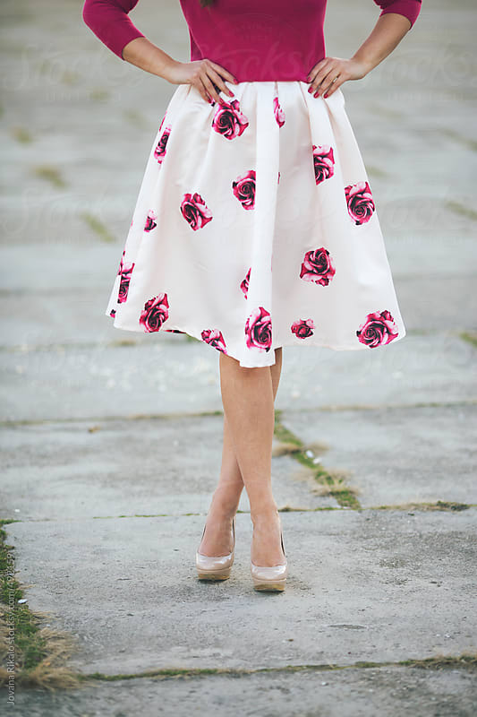 Young woman in a floral skirt by Jovana Rikalo for Stocksy United