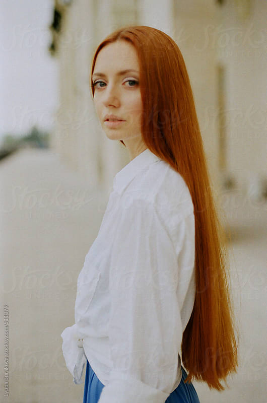 Portrait of the woman with extremely long ginger hair by Lyuba Burakova for Stocksy United
