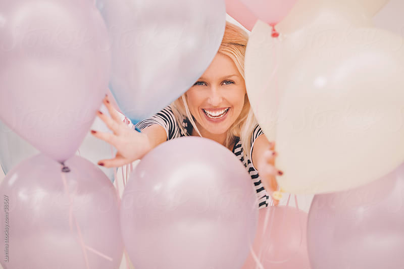 Woman Playing with Balloons by Lumina for Stocksy United