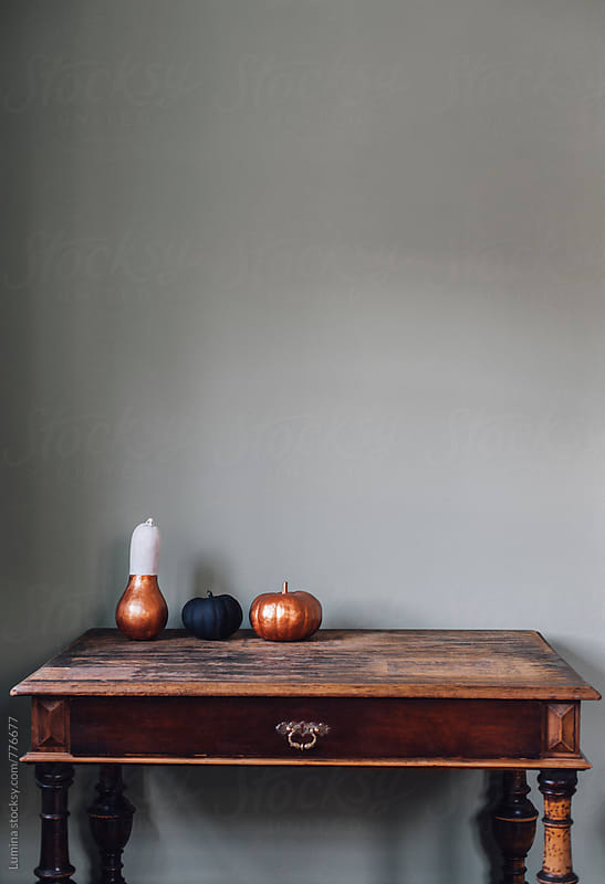 Pumpkins on a Table by Lumina for Stocksy United