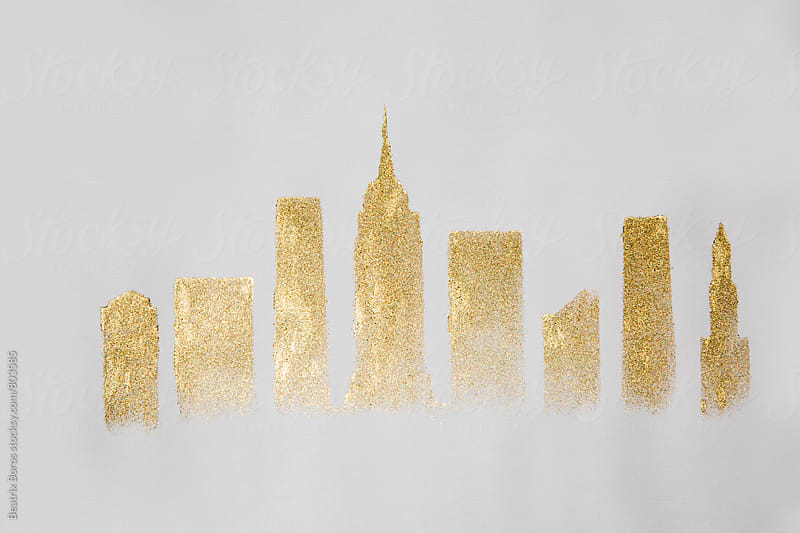 New york silhouette painted with golden glitter on white paper by Beatrix Boros for Stocksy United