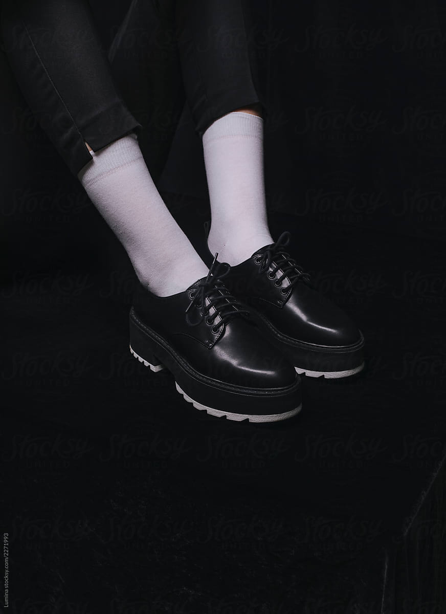 A Woman Wearing Black Shoes and White