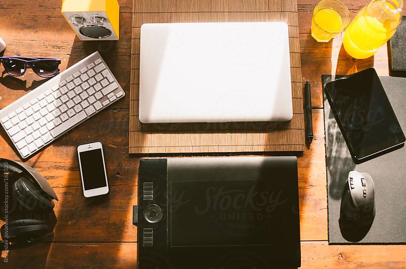 Designer's desk with gadgets by Branislav Jovanovic for Stocksy United
