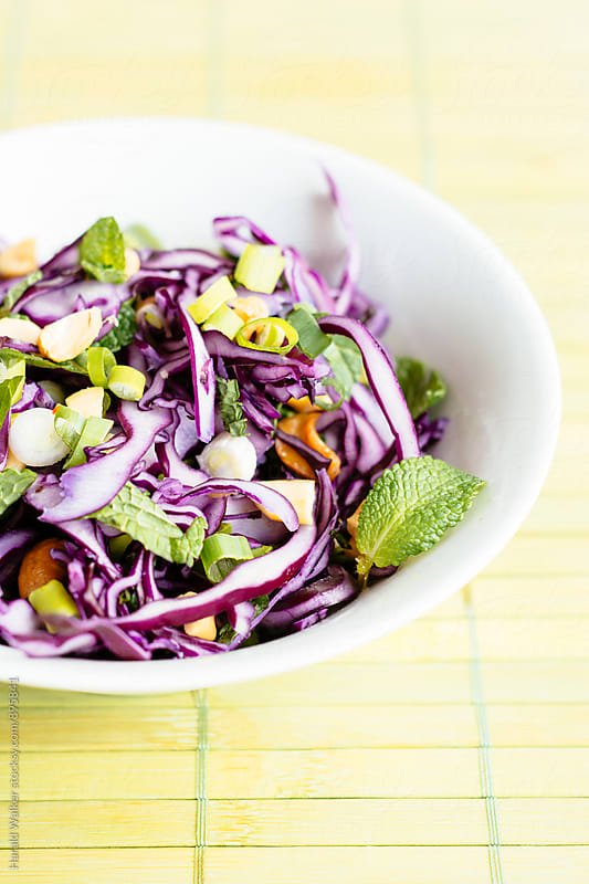 Asian red cabbage slaw with peanuts, scallions and mint by Harald Walker for Stocksy United