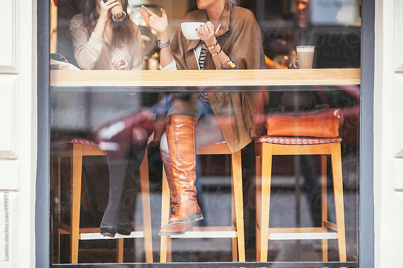 Smiling Women Drinking Coffee at a Coffee Shop by Lumina for Stocksy United