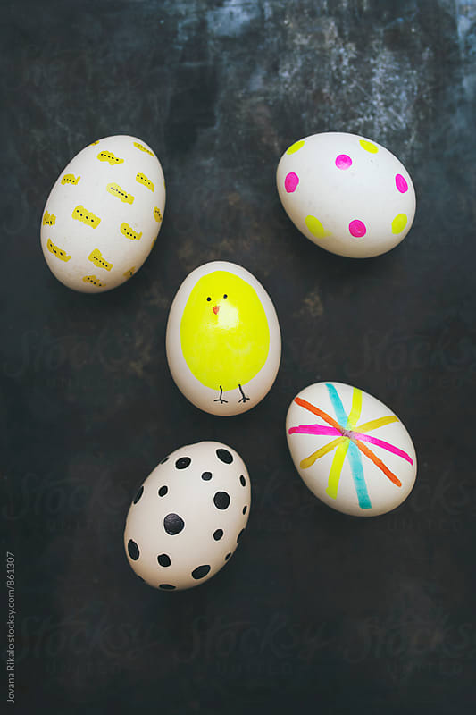 Decorated Easter eggs on a black background by Jovana Rikalo for Stocksy United
