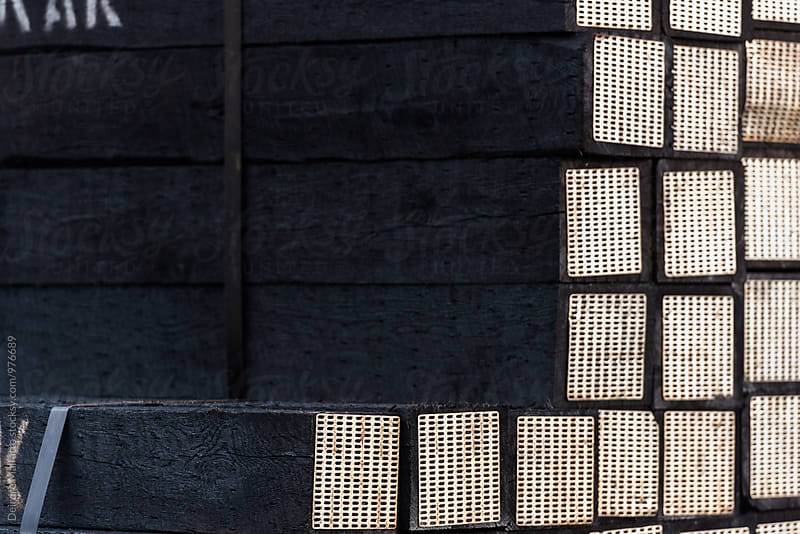 Stacked railway ties or sleepers in a train yard by Deirdre Malfatto for Stocksy United