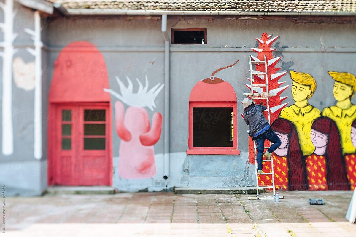 Female Graffiti Artist Writing On Wall By Pixel Stories Artist Graffiti Stocksy United