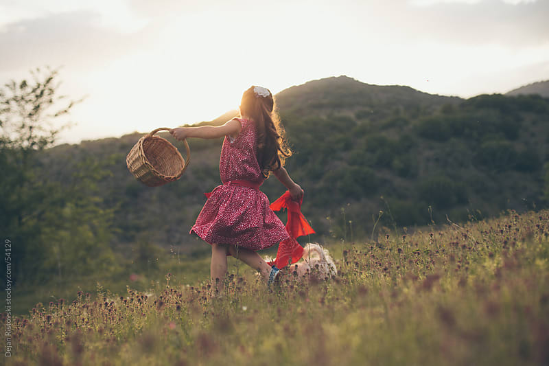 Child playing on a field by Dejan Ristovski for Stocksy United