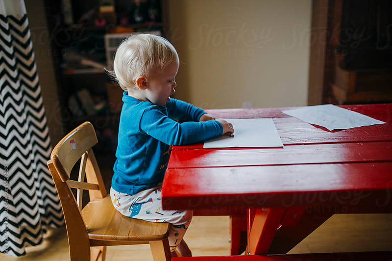 Toddler Boy Colors at the Kitchen Table by Amanda Voelker for Stocksy United