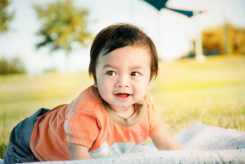 Happy Asian baby ready to explore at a park by yuko hirao for Stocksy United