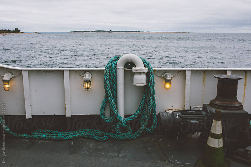 Blue rope on a boat at sea by Douglas Robichaud for Stocksy United