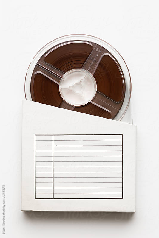 Tape reel emerging from box by Pixel Stories for Stocksy United