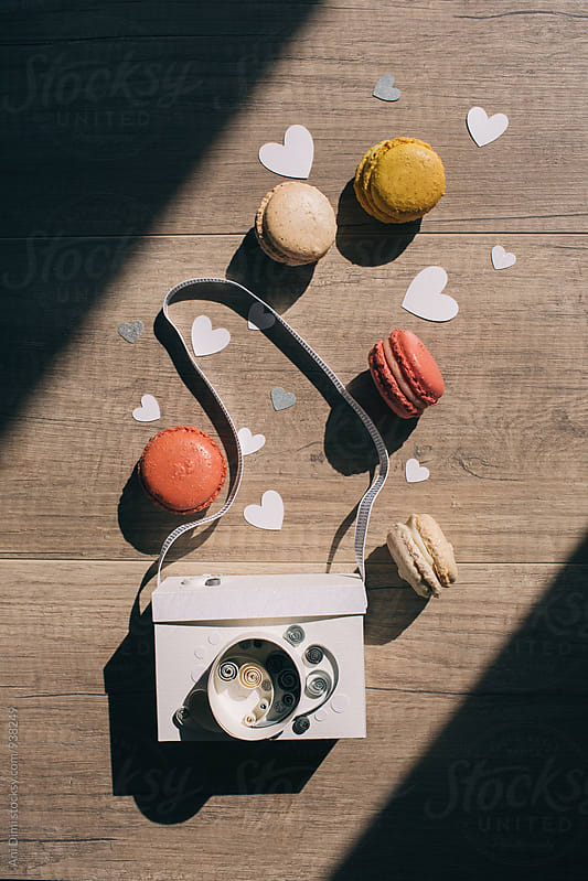 Macaroon and paper camera on wooden background  by Ani Dimi for Stocksy United