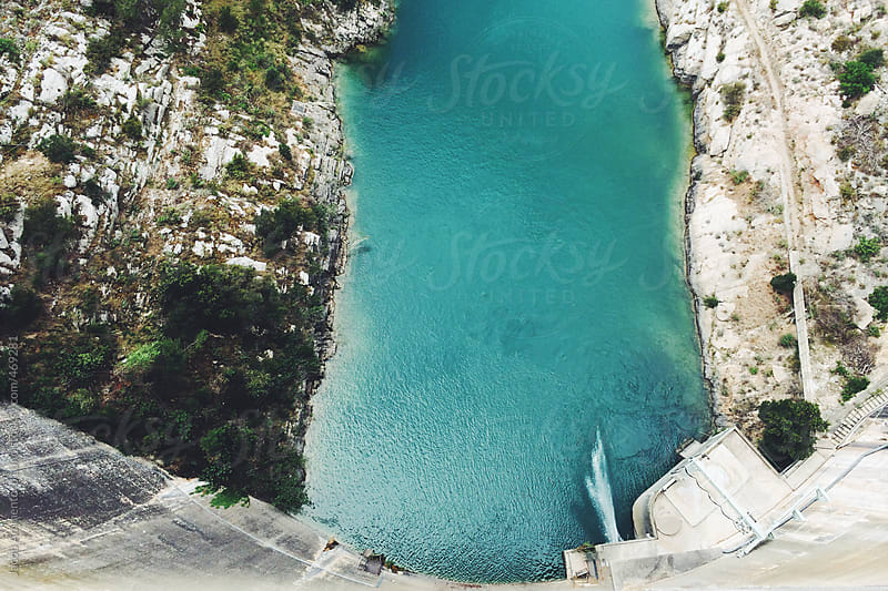 View from a dam down into a river by Jacob Ammentorp Lund for Stocksy United