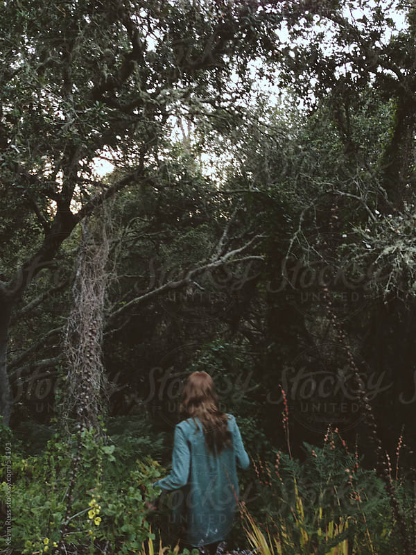 Woman Walking into Dense Forest by Kevin Russ for Stocksy United