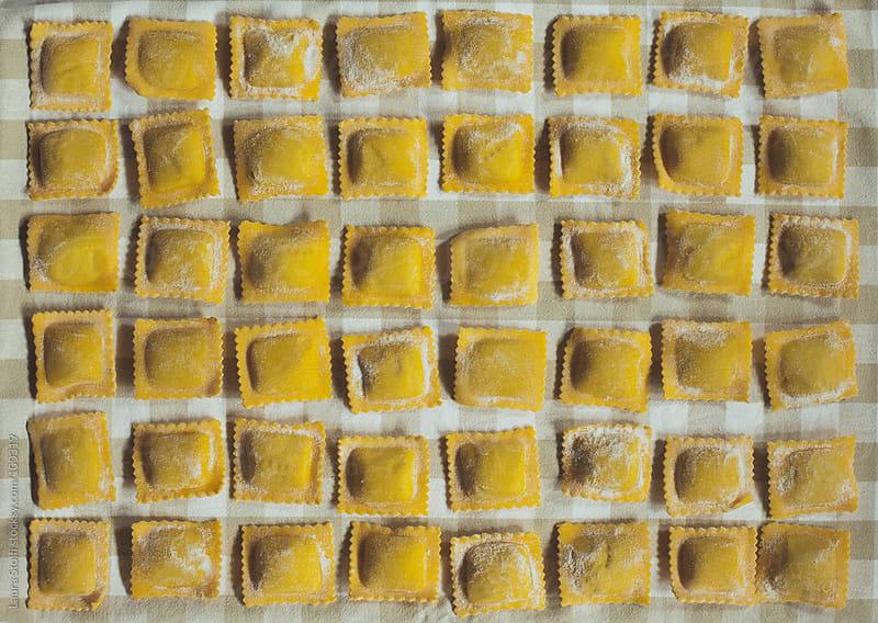 Raw homemade fresh italian ravioli by Laura Stolfi for Stocksy United