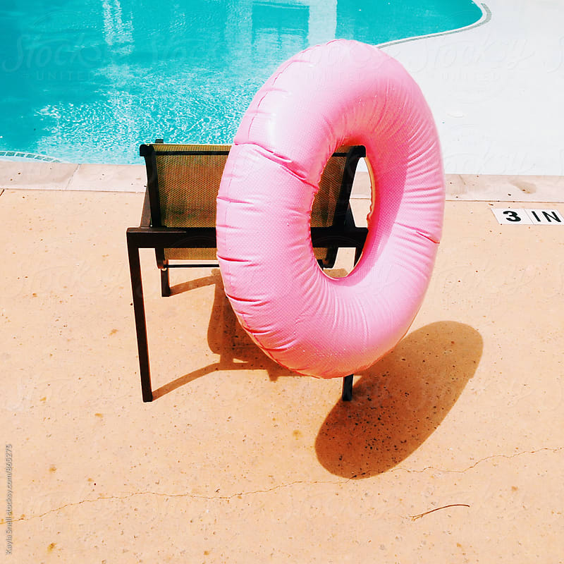 Pool float on a chair by Kayla Snell for Stocksy United