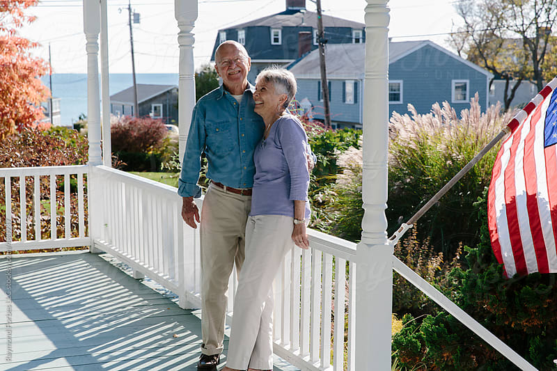 Senior Couple on Porch by Raymond Forbes LLC for Stocksy United