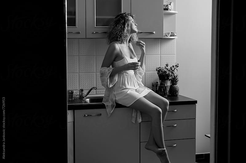Beautiful Blond Woman Drinking Morning Coffee in the Kitchen by Aleksandra Jankovic for Stocksy United