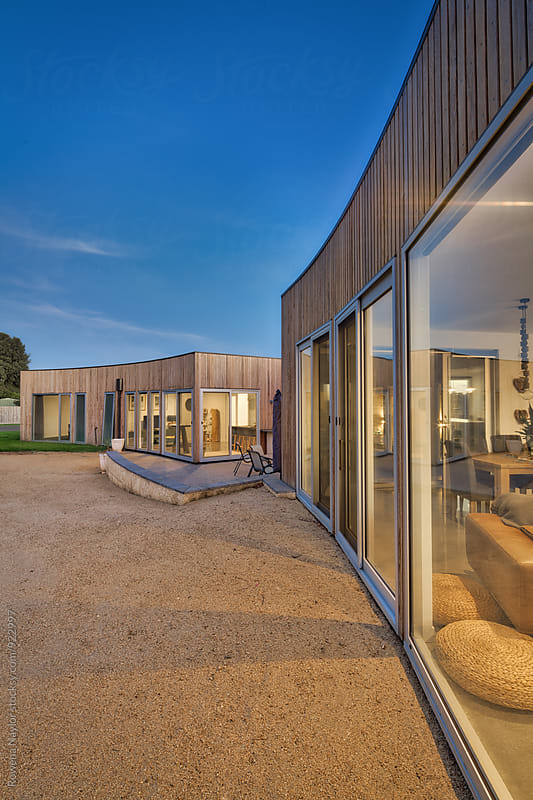 Contemporary Home at twilight by Rowena Naylor for Stocksy United