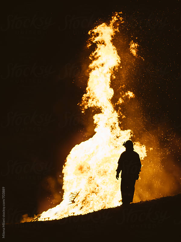 Silhouette of a firefighter by Milena Milani for Stocksy United