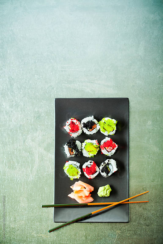 Food: Plate of Sushi with Chopsticks by Sean Locke for Stocksy United
