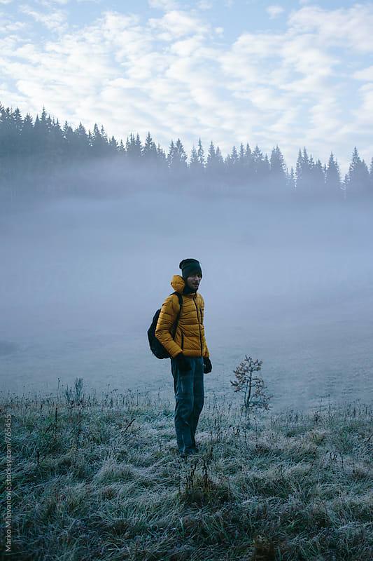 Man in foggy landscape by Marko Milovanović for Stocksy United