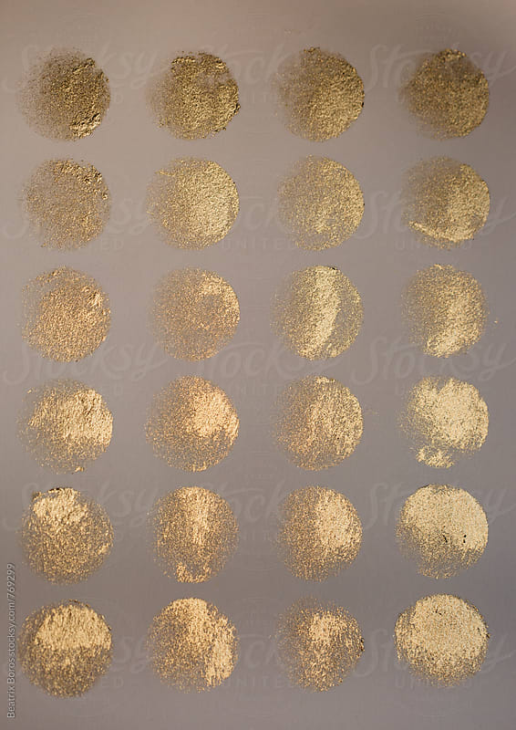 Overhead photo of golden color palette  by Beatrix Boros for Stocksy United
