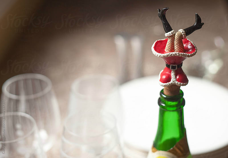 Sexy santa girl wine cork at Christmastime by Carolyn Lagattuta for Stocksy United