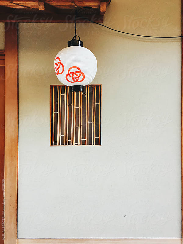 Japanese Aesthetics - Paper Lantern in Front of Bamboo Window by VISUALSPECTRUM for Stocksy United