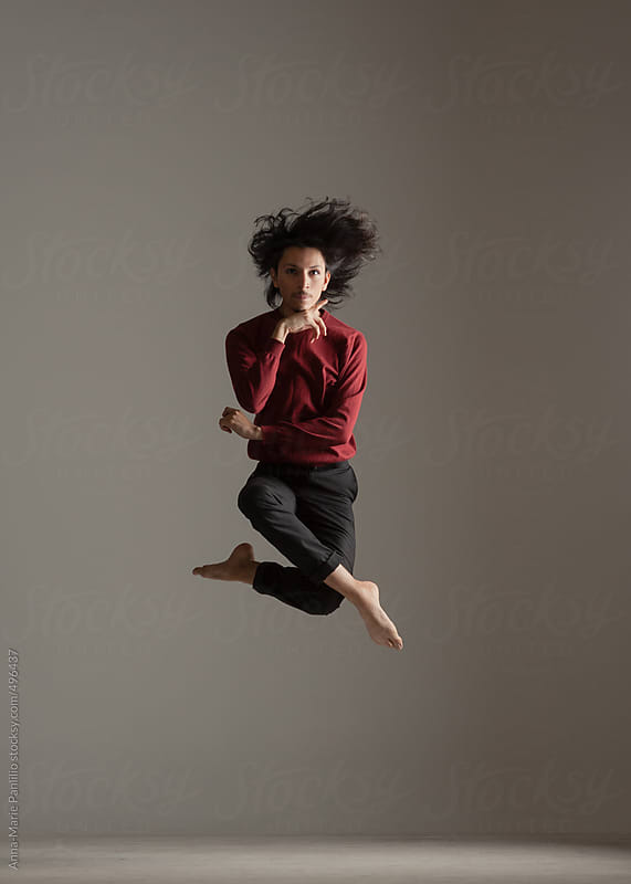 Male contemporary dancer leaping  by Anna-Marie Panlilio for Stocksy United