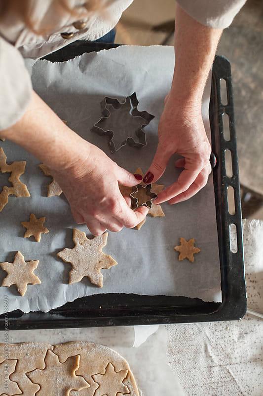 Preparing Christmas cookies by Jelena Jojic Tomic for Stocksy United