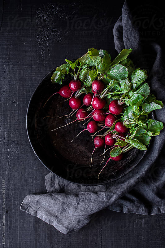 Radishes on a metal plate by KEMA Food Culture for Stocksy United