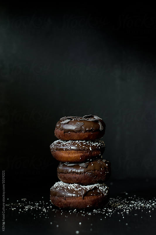 Homemade baked donuts with chocolate and coconut by KEMA Food Culture for Stocksy United