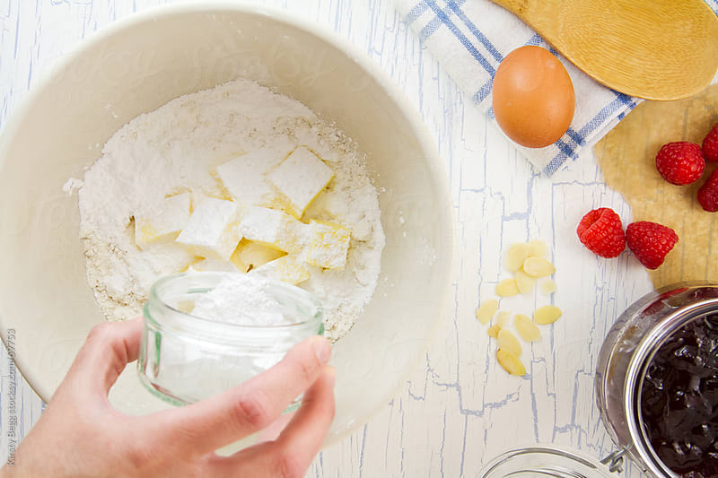 Flour, cubed butter and sugar in mixing bowl for sweet pastry by Kirsty Begg for Stocksy United