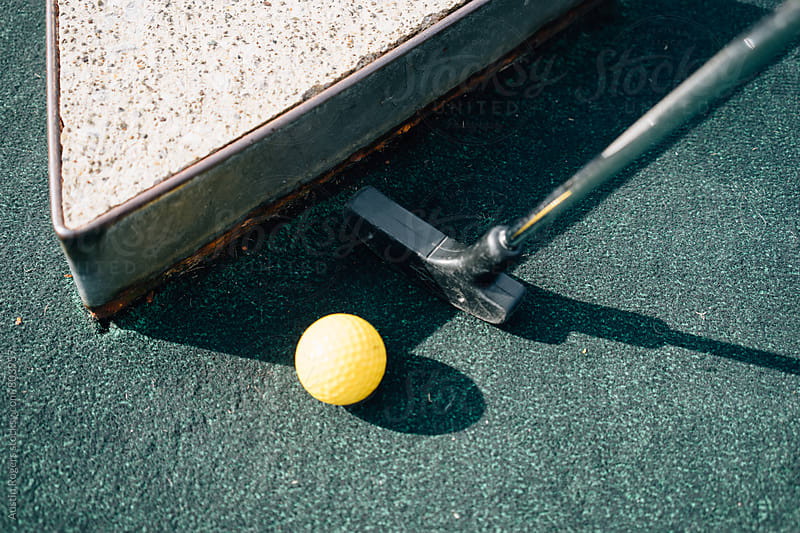 Putter and Golf Ball Against Concrete Barrier  by Austin Rogers for Stocksy United