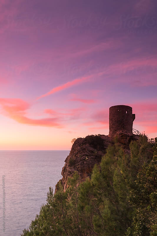 Old watchtower at a vibrant sunset   by Marilar Irastorza for Stocksy United