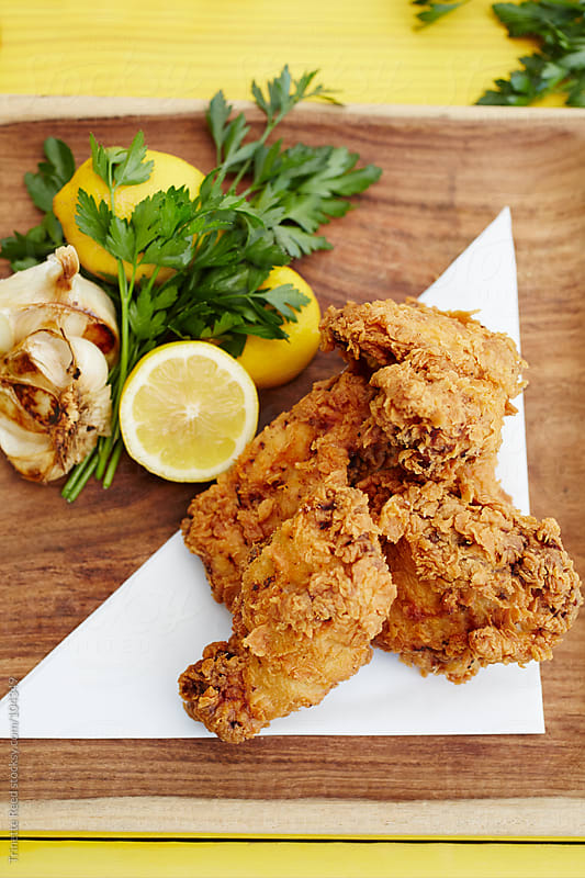Gourmet fried chicken with lemon and garlic  by Trinette Reed for Stocksy United