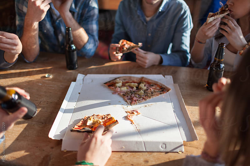Best Friends Sharing Pizza Together by HEX. for Stocksy United