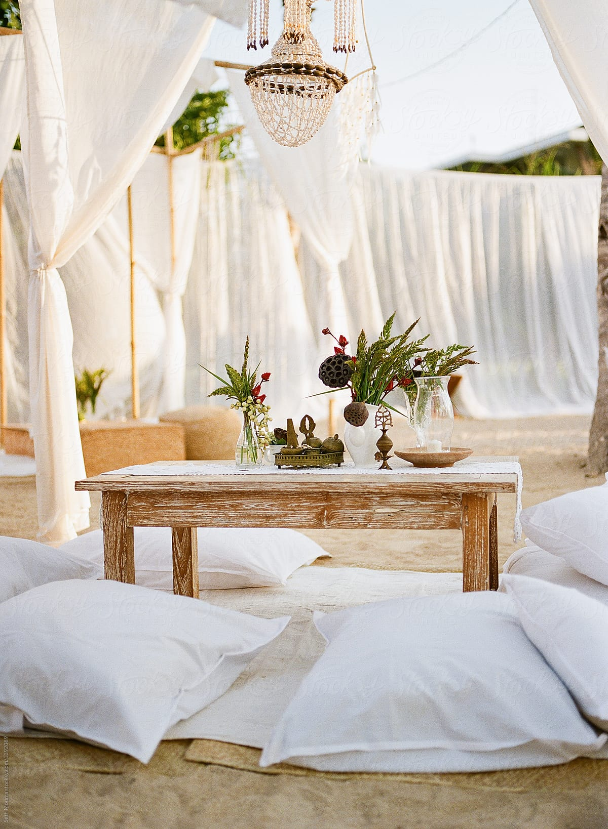 Picture of: Rustic Boho Beach Style Outdoor Seating By Seth Mourra Beach Dinner Party Stocksy United