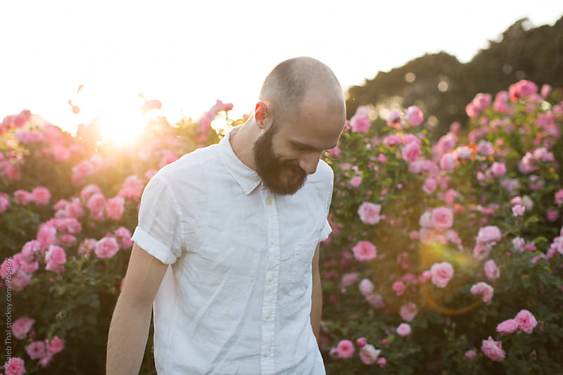 Young Bearded Man with Flowers by Caleb Thal for Stocksy United
