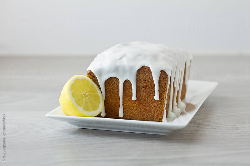 Lemon Loaf glazed and whole by Kirsty Begg for Stocksy United
