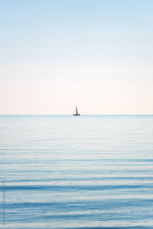 Lonely boat in the sea by Luca Pierro for Stocksy United
