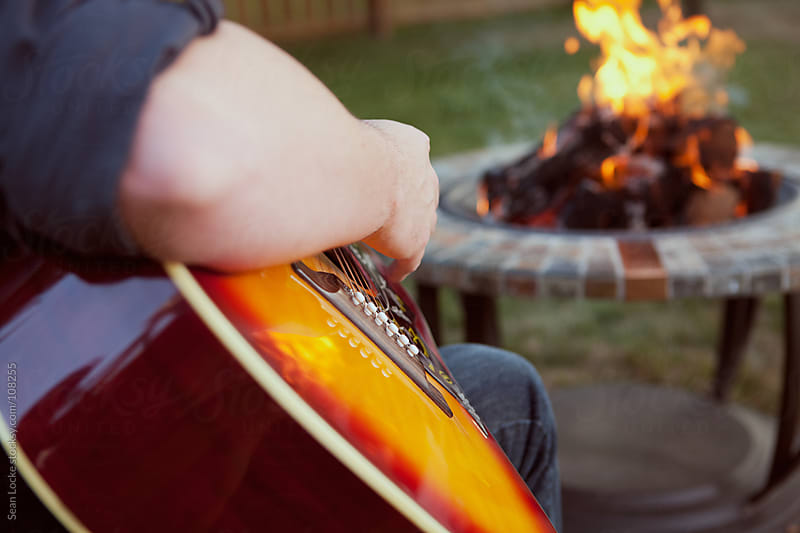 Party: Man Playing Tunes By Fire by Sean Locke for Stocksy United