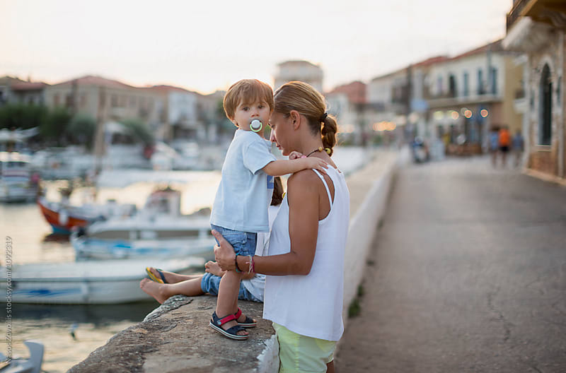 Mother and her 1 year old son outdoor by Nasos Zovoilis for Stocksy United