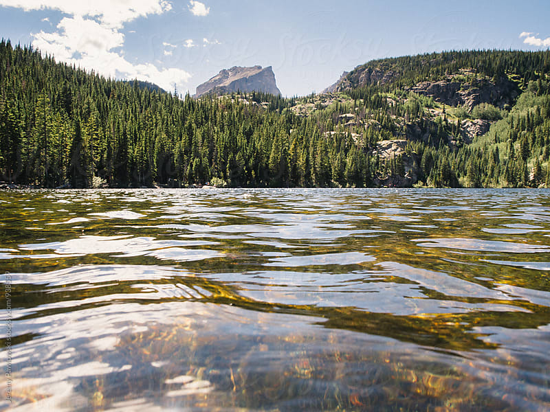 Lake with trees and mountains. Rock Mountain National Park, Colorado by Jeremy Pawlowski for Stocksy United