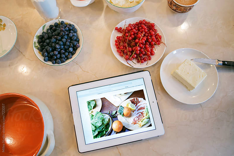 Berries and tablet by Milles Studio for Stocksy United